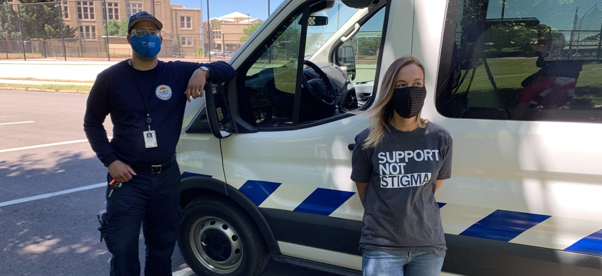 Two of the staff for Denver's new STAR program, Dustin Yancy with Denver Health Paramedics (left) and Carleigh Sailon with the Mental Health Center of Denver.