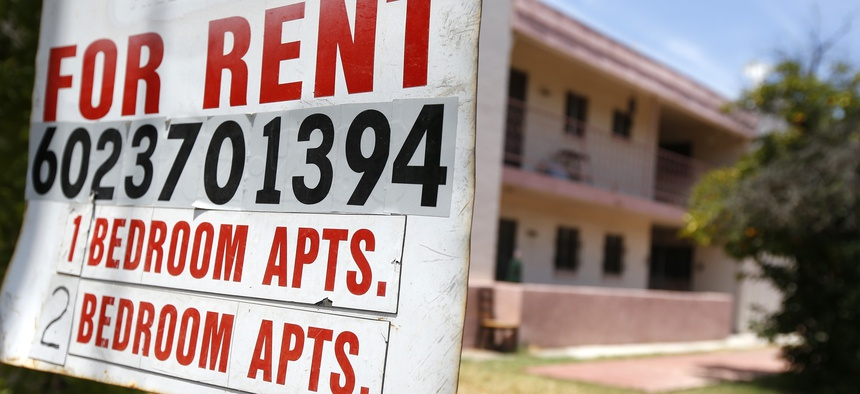 A rental sign is posted in front of an apartment complex Tuesday, July 14, 2020, in Phoenix.