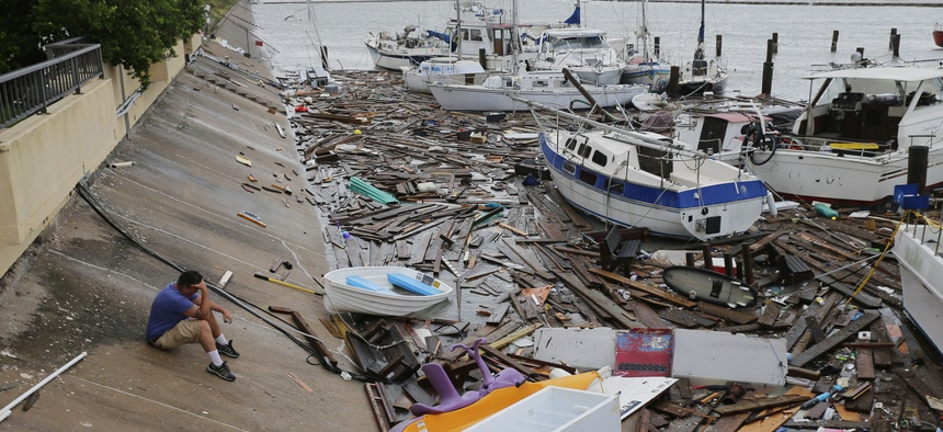 Allen Heath surveys the damage to a private marina after it was hit by Hurricane Hanna on July 26, 2020, in Corpus Christi, Texas. Heath's boat and about 30 others were lost or damaged.