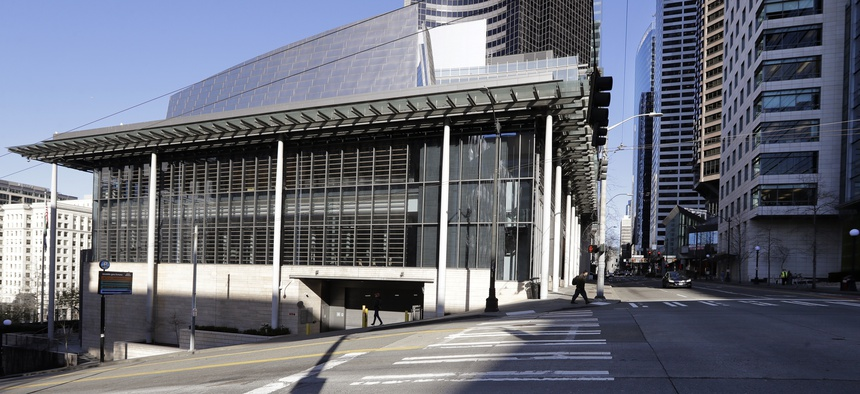 On March 16, 2020, normally bustling streets are nearly deserted adjacent to Seattle City Hall, where workers there and most in the area have been asked to work from home.