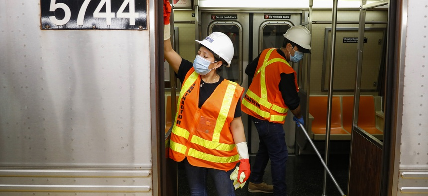 Contractors clean subway cars at the 96th Street station in New York City to try to control the spread of Covid-19.