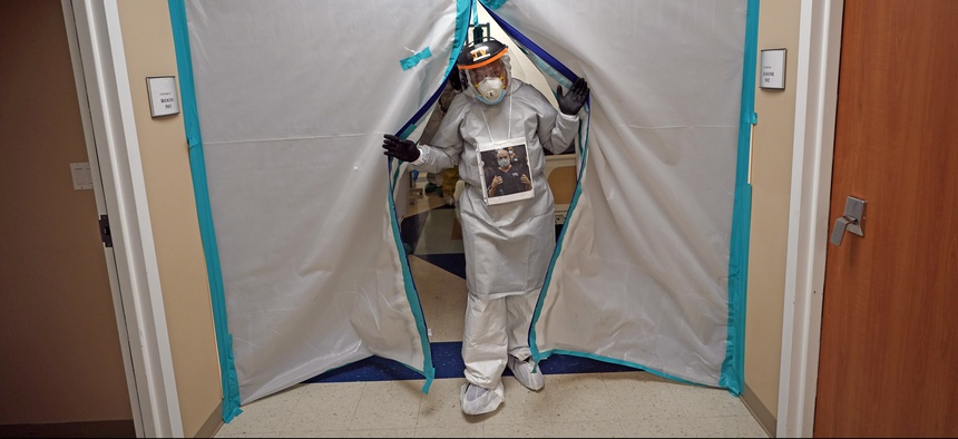Dr. Joseph Varon enters a patient wing inside the Coronavirus Unit at United Memorial Medical Center on July 6, 2020, in Houston.