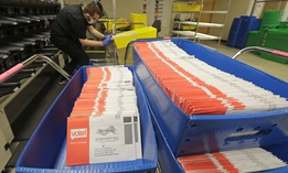 In this Aug. 5, 2020, file photo, vote-by-mail ballots are shown in sorting trays at the King County Elections headquarters in Renton, Wash., south of Seattle.